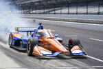 Scott Dixon, of New Zealand, pulls out of the pit following a pit stop during IndyCar auto race at Indianapolis Motor Speedway, Saturday, Aug. 14, 2021, in Indianapolis. (AP Photo/Darron Cummings)