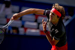 Alexander Zverev of Germany serves against Alex De Minaur of Australia during their men's singles match of the Shanghai Masters tennis tournament at Qizhong Forest Sports City Tennis Center in Shanghai, China, Thursday, Oct. 11, 2018. (AP Photo/Andy Wong)