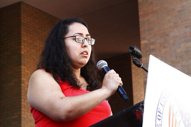 FILE - In this Aug. 10, 2019, file photo, Jessica Coca Garcia stands in front of her wheelchair addressing those gathered at the League of United Latin American Citizens'
