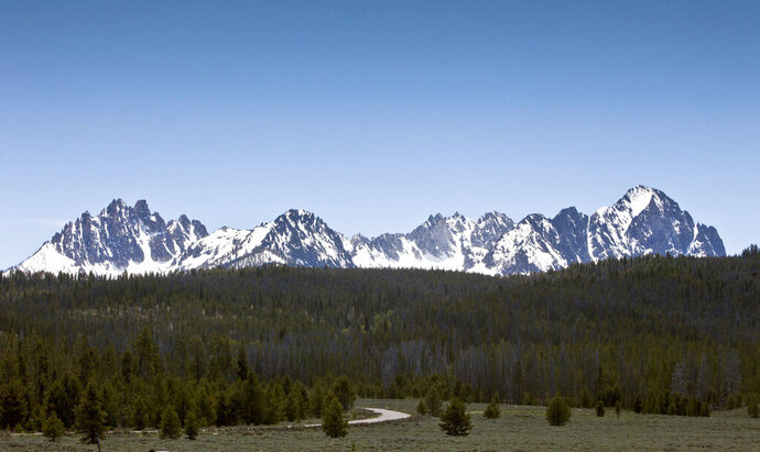 FILE - This June 1, 2012 file photo shows the Sawtooth National Recreation Area near Stanley, Idaho. A federal judge has ruled that work can continue on a public trail on an easement crossing private land that connects the popular tourist destinations of Redfish Lake and Stanley in central Idaho. U.S. Magistrate Judge Candy Dale on Tuesday, June 30, 2020, rejected a request by David Boren and Lynn Arnone to stop work on the trail that crosses Sawtooth Mountain Ranch. (Darin Oswald/Idaho Statesman via AP, File)