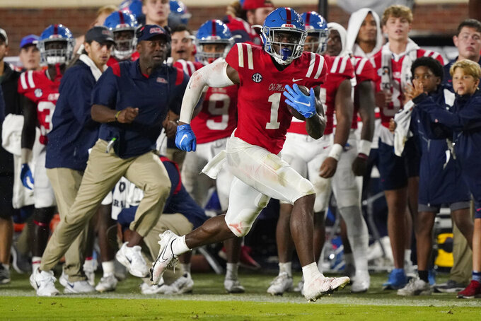 Mississippi wide receiver Jonathan Mingo (1) runs along the sideline after catching a pass against Tulane during the first half of an NCAA college football game Saturday, Sept. 18, 2021, in Oxford, Miss. (AP Photo/Rogelio V. Solis)