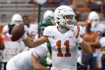FILE - In this Oct. 24, 2020, file photo, Texas' Sam Ehlinger (11) looks to pass against Baylor during the first half of an NCAA college football game in Austin, Texas. Ehlinger is the last of the Longhorns' 2020 season captains still standing. The others have either opted out of playing the Alamo Bowl against Colorado or will miss the game for an injury. (AP Photo/Chuck Burton, File)