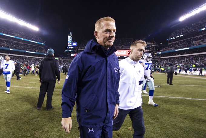 Dallas Cowboys head coach Jason Garrett, center left, walks off the field after of an NFL football game against the Philadelphia Eagles, Sunday, Dec. 22, 2019, in Philadelphia (AP Photo/Chris Szagola)