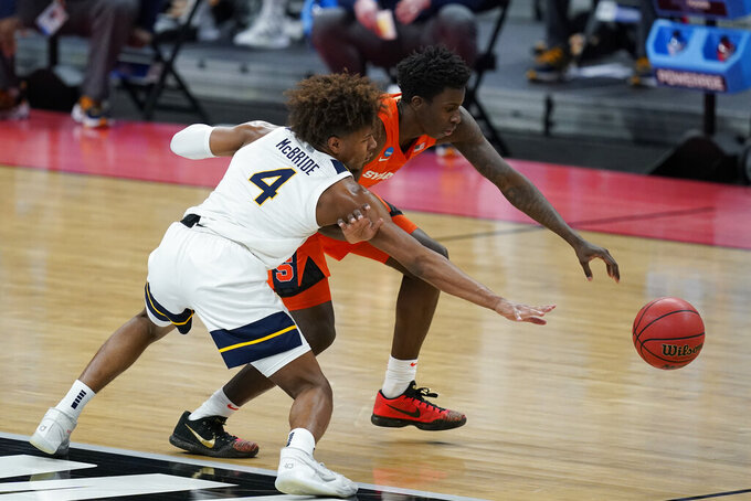 Syracuse's Kadary Richmond (3) is defended by West Virginia's Miles McBride (4) during the first half of a second-round game in the NCAA men's college basketball tournament at Bankers Life Fieldhouse, Sunday, March 21, 2021, in Indianapolis. (AP Photo/Darron Cummings)
