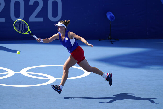 Barbora Krejcikova, of the Czech Republic, returns to Belinda Bencic, of Switzerland, during second round of the men's tennis competition at the 2020 Summer Olympics, Tuesday, July 27, 2021, in Tokyo, Japan. (AP Photo/Patrick Semansky)