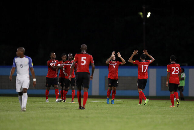 File-Trinidad and Tobago's Shahdon Winchester, center, celebrates with teammates after scoring against the U.S. at their World Cup qualifying match in Couva, Trinidad and Tobago, Tuesday, Oct. 10, 2017.  The United States could start qualifying for the 2022 World Cup in Trinidad, where the Americans flopped on the final night three years ago and failed to reach the 2018 tournament.(AP Photo/Rebecca Blackwell, File)