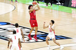 Rutgers' Ron Harper Jr., center, attempts a tying 3-point shot over Houston's Quentin Grimes, right, in the final seconds of a college basketball game in the second round of the NCAA tournament at Lucas Oil Stadium in Indianapolis Sunday, March 21, 2021. Harper missed the shot and Houston won 63-60. (AP Photo/Mark Humphrey)