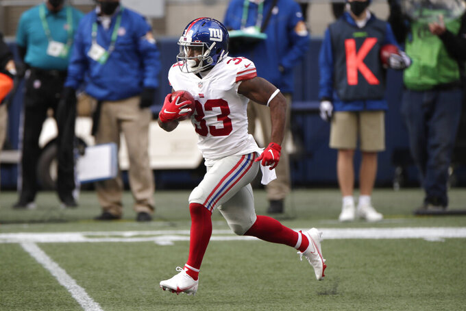 New York Giants running back Dion Lewis runs the ball during the first half of an NFL football game against the Seattle Seahawks, Sunday, Dec. 6, 2020, in Seattle. (AP Photo/Larry Maurer)