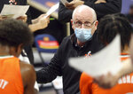 Miami head coach Jim Larrañaga talks in a huddle during an NCAA college basketball game against Virginia, Monday in Charlottesville, Va. (Andrew Shurtleff/The Daily Progress via AP, Pool)