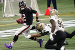 Atlanta Falcons quarterback Matt Ryan (2) runs against the New Orleans Saints during the second half of an NFL football game, Sunday, Dec. 6, 2020, in Atlanta. (AP Photo/Brynn Anderson)