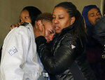 Supporters of Antwon Rose II, leave the Allegheny County Courthouse after hearing the verdict of not guilty on all charges for Michael Rosfeld, a former police officer in East Pittsburgh, Pa., Friday, March 22, 2019. Former East Pittsburgh Police Officer Michael Rosfeld was charged with homicide for shooting Antwon Rose II in the back last June. (AP Photo/Gene J. Puskar)