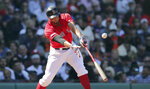 Boston Red Sox's Xander Bogaerts connects for a two RBI single during the second inning of a baseball game against the San Francisco Giants at Fenway Park in Boston, Thursday, Sept. 19, 2019. (AP Photo/Charles Krupa)