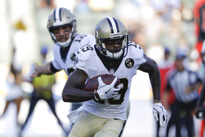 FILE - In this Saturday, Aug. 25, 2018 file photo, New Orleans Saints wide receiver Ted Ginn runs with the ball during the first half of an NFL preseason football game against the Los Angeles Chargers in Carson, Calif. Saints receiver Ted Ginn Jr. says speed remains his most distinguishing asset as he enters his 13th NFL season. The 34-year-old former Ohio State star says he worried knee problems that wiped out much of last season might force his retirement. But now he says he's confident he remains among football's fastest after offseason workouts emphasizing agility and flexibility and a change in diet. (AP Photo/Marcio Jose Sanchez, File)