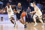 Nevada guard Jalen Harris (2) drives between Saint Mary's forwards Malik Fitts (24) and Matthias Tass during the first half of an NCAA college basketball game on Saturday, Dec. 21, 2019, in San Francisco. (AP Photo/D. Ross Cameron)