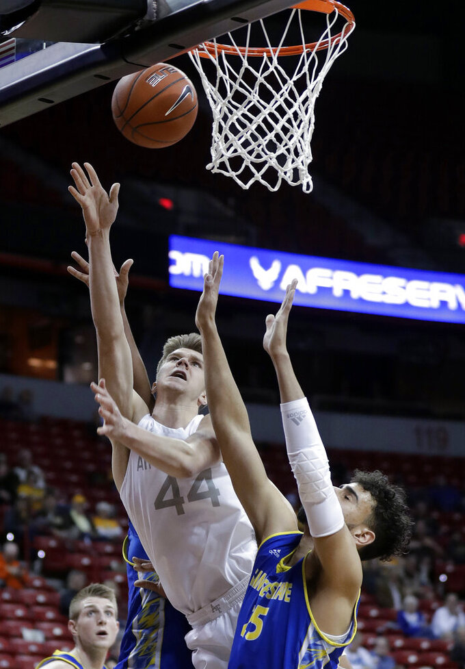 San Jose State's Craig LeCesne (25) defends as Air Force's Keaton Van Soelen (44) shoots during the first half of an NCAA college basketball game in the Mountain West Conference men's tournament Wednesday, March 13, 2019, in Las Vegas. (AP Photo/Isaac Brekken)