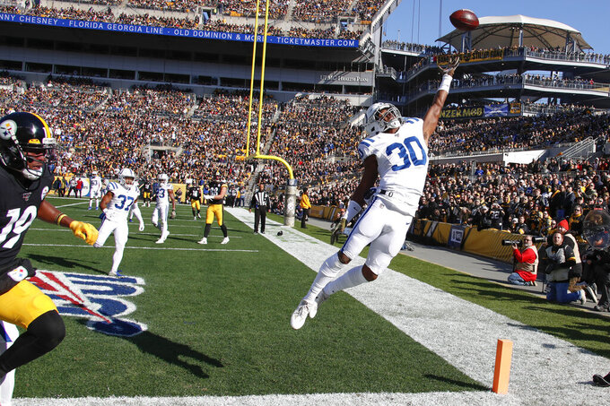 Indianapolis Colts defensive back George Odum (30) leaps for a pass intended for Pittsburgh Steelers wide receiver JuJu Smith-Schuster (19) an NFL football game, Sunday, Nov. 3, 2019, in Pittsburgh. The ball landed out of bounds. (AP Photo/Gene J. Puskar)