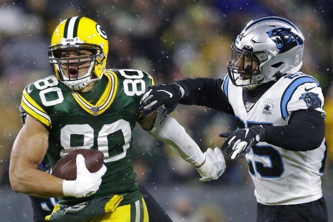 Green Bay Packers' Jimmy Graham tries to get past Carolina Panthers' Eric Reid after catching a pass during the first half of an NFL football game Sunday, Nov. 10, 2019, in Green Bay, Wis. (AP Photo/Jeffrey Phelps)