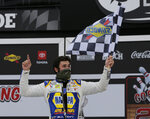 Chase Elliott celebrates in Victory Lane after winning a NASCAR Cup Series auto race at Daytona International Speedway, Sunday, Aug. 16, 2020, in Daytona Beach, Fla. (AP Photo/Terry Renna)
