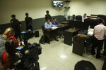 FILE - In this Oct. 11, 2019 file photo, lawyer Eduardo Rubi, center left, sitting in light blue shirt, appears in court with his client Orlando Tercero in Managua, Nicaragua.  Moreno is accused of killing 22-year-old U.S. nursing student Haley Anderson in 2018.  The court proceeding is taking place in Managua, Nicaragua, with a Nicaraguan prosecutor and a Nicaraguan judge applying that country's law. Witnesses have been testifying from Binghamton via streaming video. (AP Photo/Oscar Duarte, File)