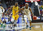 Michigan State guard Cassius Winston (5) drives up court past Minnesota guard Dupree McBrayer during a second round men's college basketball game in the NCAA Tournament, Saturday, March 23, 2019, in Des Moines, Iowa. (AP Photo/Charlie Neibergall)