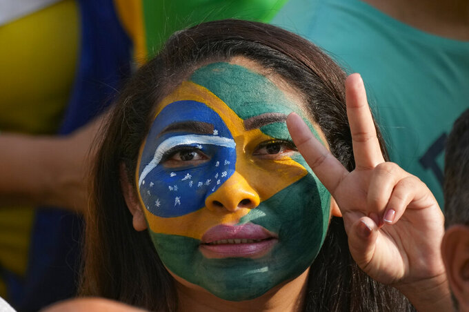 A supporter of Brazilian President Jair Bolsonaro attends a rally on Independence Day in Sao Paulo, Brazil, Tuesday, Sept. 7, 2021. (AP Photo/Andre Penner)