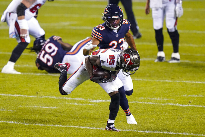 Tampa Bay Buccaneers wide receiver Jaydon Mickens (85) makes catch in front of Chicago Bears cornerback Kyle Fuller (23) during the first half of an NFL football game in Chicago, Thursday, Oct. 8, 2020. (AP Photo/Nam Y. Huh)