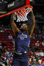 Nevada forward Jordan Caroline dunks the ball during practice at the NCAA men's college basketball tournament, Wednesday, March 20, 2019, in Des Moines, Iowa. Nevada plays Florida on Thursday. (AP Photo/Charlie Neibergall)