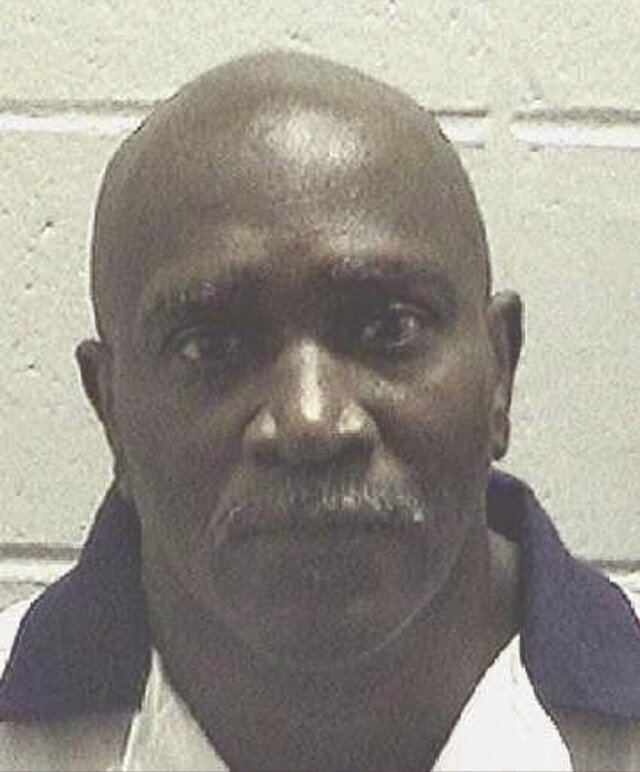 """This undated booking photo provided by the Georgia Department of Corrections shows Keith """"Bo"""" Tharpe. The Georgia death row inmate whose planned execution was halted in September 2017 by the U.S. Supreme Court after his lawyers argued his death sentence was tainted by a juror's racial bias died of natural causes Friday, Jan. 24, 2020, according to the state Department of Corrections. He was 61. (Georgia Department of Corrections via AP)"""