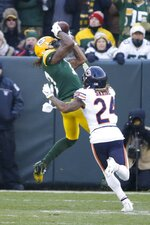 Green Bay Packers' Davante Adams catches a touchdown pass in front of Chicago Bears' Buster Skrine during the first half of an NFL football game Sunday, Dec. 15, 2019, in Green Bay, Wis. (AP Photo/Mike Roemer)