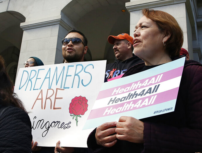 FILE - In this May 20, 2019, file photo, supporters of proposals to expand California's government-funded health care benefits to undocumented immigrants gathered at the Capitol for the Immigrants Day of Action in Sacramento, Calif. California became the first state to offer taxpayer-funded health benefits to young adults living in the country illegally as Democratic Gov. Gavin Newsom signed a bill into law on Tuesday, July 9, that makes low-income adults age 25 and younger eligible for the state's Medicaid program regardless of their immigration status. (AP Photo/Rich Pedroncelli, File)