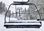 In this Tuesday, May 21, 2019, photo provided by Squaw Valley Alpine Meadows, is a snow covered chair lift at the Squaw Valley Ski Resort in Olympic Valley, Calif. Memorial Day may be the unofficial start of summer, but California is heading toward the holiday with rainy, windy and snowy weather. The Squaw Valley resort at Lake Tahoe reports it got 32 inches of snow over the past seven days, boosting its season total to 714 inches. Unsettled weather will continue into next week. (Ben Arnst/Squaw Valley Alpine Meadows via AP)