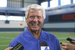 FILE - In this Wednesday, Aug. 21, 2019, file photo, former Miami football coach Jimmy Johnson talks to the media after an NCAA college football practice in Coral Gables, Fla. Johnson, who coached the Dallas Cowboys to two Super Bowl championships in the 1990s, has been elected to the Pro Football Hall of Fame. (David Santiago/Miami Herald via AP, File)