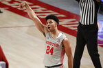 Houston guard Quentin Grimes (24) reacts after making a three point basket during the second half of an NCAA college basketball game against Western Kentucky, Thursday, Feb. 25, 2021, in Houston. (AP Photo/Eric Christian Smith)