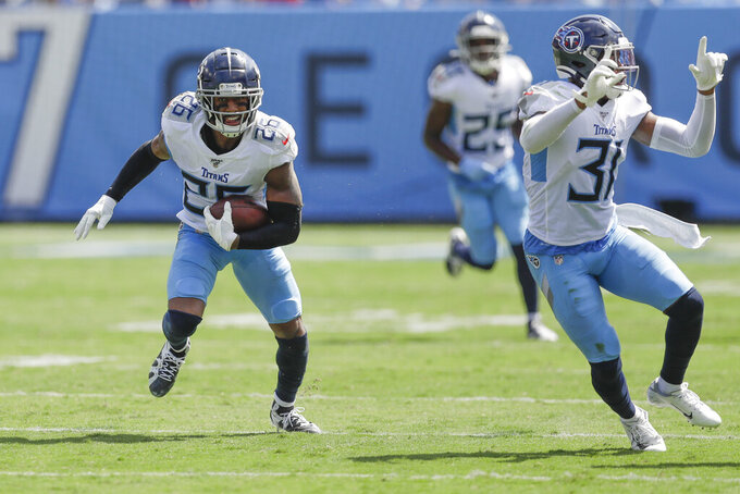 Tennessee Titans cornerback Logan Ryan (26) runs the ball back after he intercepted a pass against the Indianapolis Colts in the first half of an NFL football game Sunday, Sept. 15, 2019, in Nashville, Tenn. Ryan was ruled down where the interception was made. (AP Photo/James Kenney)