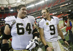 FILE - In this Jan. 3, 2016, file photo, New Orleans Saints quarterback Drew Brees (9) walks off the field with New Orleans Saints tackle Zach Strief (64) after the second half of an NFL football game against the Atlanta Falcons, in Atlanta. Strief says he's retiring after 12 NFL seasons. Strief, who made a tearful announcement on Monday, March 12, 2018, in Metairie, La., says his career far exceeded his expectations.  (AP Photo/David Goldman, File)