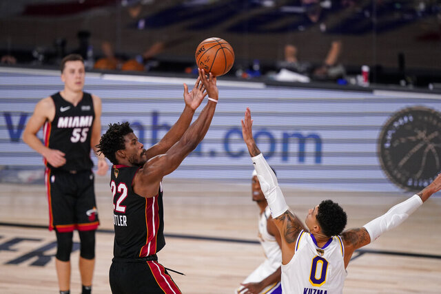 Miami Heat's Jimmy Butler (22) shoots against Los Angeles Lakers' Kyle Kuzma (0) during the second half in Game 3 of basketball's NBA Finals, Sunday, Oct. 4, 2020, in Lake Buena Vista, Fla. (AP Photo/Mark J. Terrill)