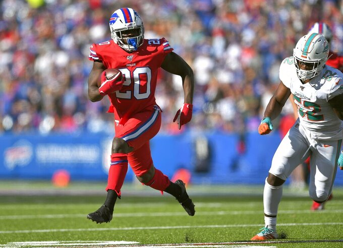 Buffalo Bills running back Frank Gore runs away from Miami Dolphins middle linebacker Raekwon McMillan in the second half of an NFL football game, Sunday, Oct. 20, 2019, in Orchard Park, N.Y. (AP Photo/Adrian Kraus)
