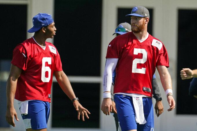 Indianapolis Colts quarterback Carson Wentz (2) talks with quarterback Jalen Morton (6) runs a drill during NFL football practice, Thursday, May 20, 2021, in Indianapolis. (AP Photo/Darron Cummings)