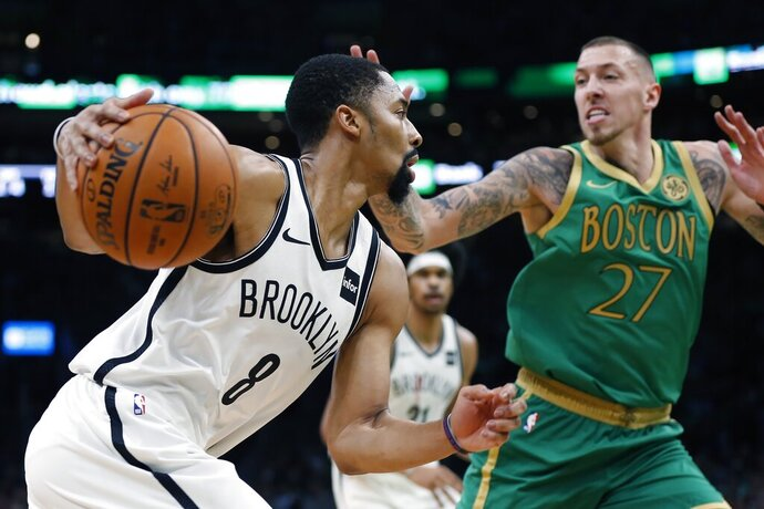 Brooklyn Nets' Spencer Dinwiddie (8) drives past Boston Celtics' Daniel Theis (27) during the first half of an NBA basketball game in Boston, Wednesday, Nov. 27, 2019. (AP Photo/Michael Dwyer)