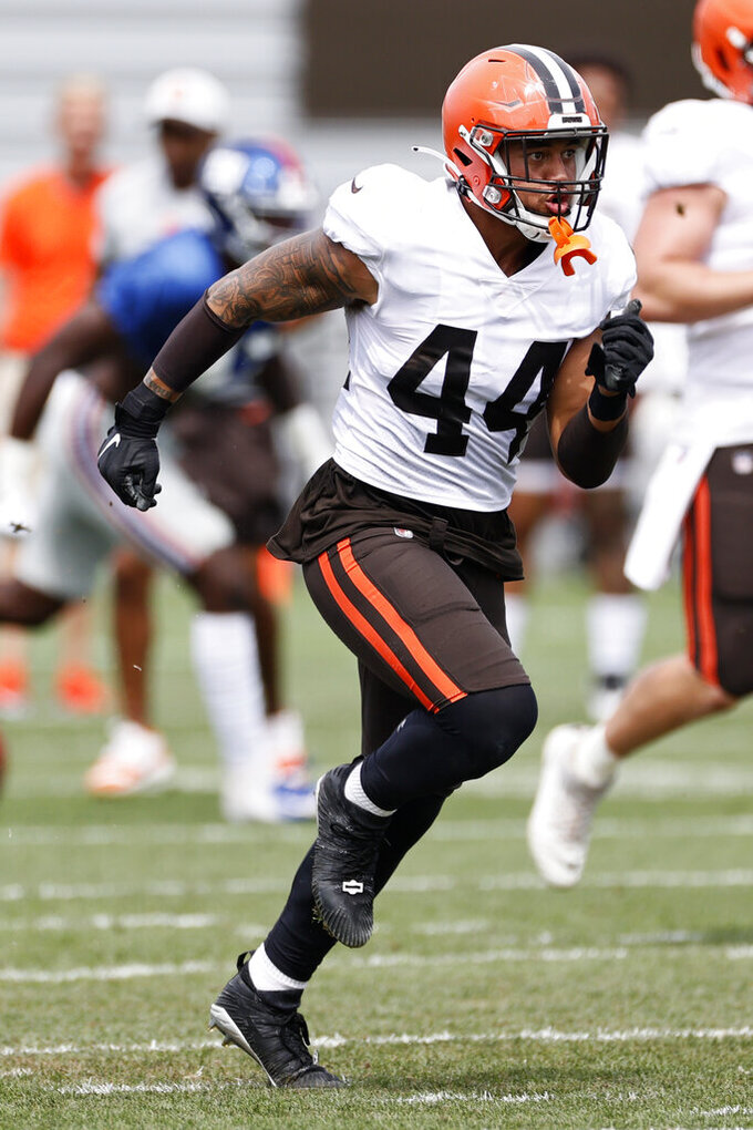 Cleveland Browns linebacker Sione Takitaki (44) runs through a special teams drill against the New York Giants during a joint NFL football training camp practice Thursday, Aug. 19, 2021, in Berea, Ohio. (AP Photo/Ron Schwane)