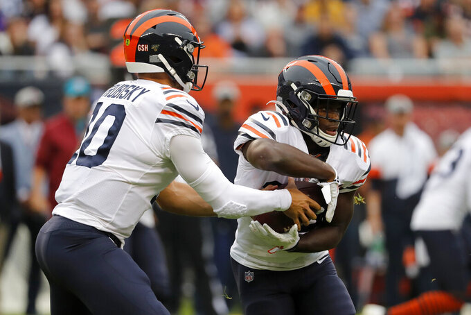 Chicago Bears quarterback Mitchell Trubisky, left, hands off to running back Tarik Cohen during the half of an NFL football game against the Minnesota Vikings Sunday, Sept. 29, 2019, in Chicago. (AP Photo/Jeff Roberson)