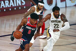 Washington Wizards forward Rui Hachimura (8) brings the ball up court against New Orleans Pelicans center Derrick Favors (22) during the second half of an NBA basketball game Friday, Aug. 7, 2020, in Lake Buena Vista, Fla. (Kim Klement/Pool Photo via AP)