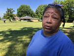 "Giwada ""Gi Gi"" Williams, a resident of Canton, Miss., waits to see Democratic presidential candidate Beto O'Rourke on Friday, Aug. 16, 2019, in Canton, Miss. Williams said she is concerned about people who were caught up in immigration raids at Mississippi chicken processing plants. (AP Photo/Emily Wagster Pettus)"