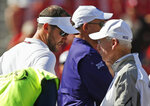Oklahoma head coach Lincoln Riley, left, talks with Kansas State head coach Bill Snyder, right, before an NCAA college football game between Kansas State and Oklahoma in Norman, Okla., Saturday, Oct. 27, 2018. (AP Photo/Sue Ogrocki)