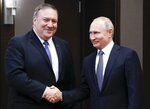 Russian President Vladimir Putin, right, and U.S. Secretary of State Mike Pompeo, pose for a photo prior to their talks in the Black Sea resort city of Sochi, southern Russia, Tuesday, May 14, 2019. Pompeo arrived in Russia for talks that are expected to focus on an array of issues including arms control and Iran. (AP Photo/Pavel Golovkin, Pool)