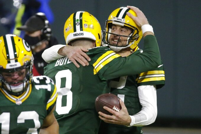 Green Bay Packers' Aaron Rodgers celebrates a touchdown pass with Tim Boyle (8) during the second half of an NFL football game against the Philadelphia Eagles Sunday, Dec. 6, 2020, in Green Bay, Wis. The pass was Rodgers' 400th career touchdown pass.(AP Photo/Mike Roemer)