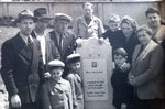 In this June 1948 photo provided by Ruth Brandspiegel, the Eisenberg and Brandspiegel families gather around the tombstone of Abraham Eisenberg at the Hallein Displaced Persons Camp in Austria. Eisenberg, father of Holocaust survivor Israel