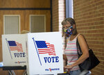 Susan Burr casts her votes during the Republican candidates primary election, Tuesday, June 23, 2020, at Hidden Valley Middle School in Roanoke, Va. (Stephanie Klein-Davis/The Roanoke Times via AP)