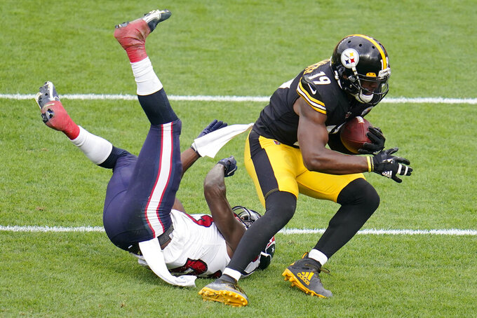 Pittsburgh Steelers wide receiver JuJu Smith-Schuster (19) catches a two point conversion pass from quarterback Ben Roethlisberger with Houston Texans free safety Eric Murray (23) defending during the second half of an NFL football game in Pittsburgh, Sunday, Sept. 27, 2020. The Steelers won 28-21. (AP Photo/Gene J. Puskar)