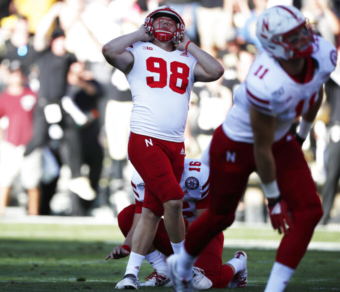 Nebraska place kicker Isaac Armstrong reacts after missing a field goal attempt to tie the score in overtime of an NCAA college football game against Colorado Saturday, Sept. 7, 2019, in Boulder, Colo. Colorado won 34-31 in overtime. (AP Photo/David Zalubowski)